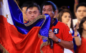 Philippine presidential candidate and Davao city mayor Rodrigo 'Digong' Duterte kisses the Philippine flag during a