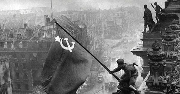Soviet soldiers raise the flag on the roof of the Reichstag building in Berlin in this archive photo, May, 1945.