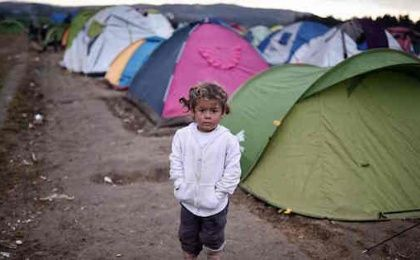 A child stands in the makeshift camp at the Greek-Macedonian border where thousands of people are stranded.