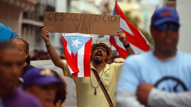 Thousands of Puerto Ricans protest against the debt crisis.