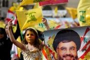 Hezbollah supporters hold posters of group's leader Hassan Nasrallah.
