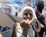 A Palestinian man holds a key as a symbol of the house he lost to Israel's occupation in 1948.