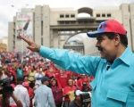 Venezuelan President Nicolas Maduro waves to a crowd that had assembled to show support for emergency measures announced by the government, Caracas, Venezuela, May 14, 2016.