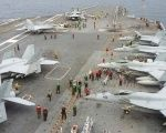 U.S fighter jets on the upper deck of the USS George Washington aircraft carrier in the South China Sea.
