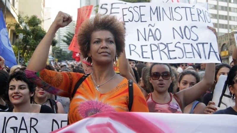 Brazilian women protest against the Senate-imposed government of Michel Temer with a sign reading
