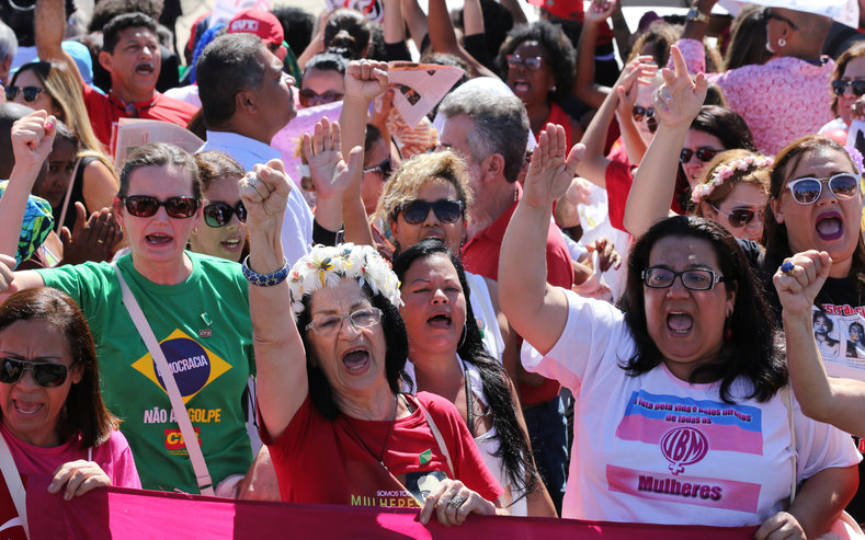 Supporters of suspended Brazilian President Dilma Rousseff shout slogans after the Brazilian Senate voted to impeach Rousseff for allegedly breaking budget laws, outside Planalto Palace in Brasilia