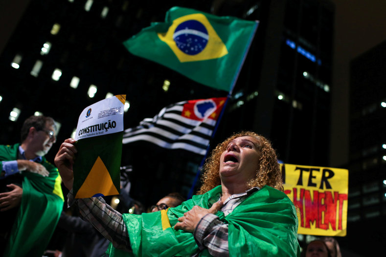 A woman protests against Brazil