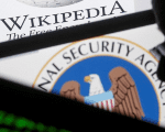 A man is seen near cyber code and the U.S. National Security Agency logo in this photo illustration taken in Sarajevo March 11, 2015