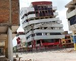 A collapsed bulding is seen at an area devasted by last month's earthquake in Portoviejo