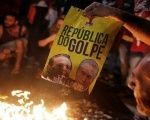 Protesters in Brazil burn a poster with the images of Senate President Calheiros (L) and Brazil's senate-imposed president Temer, in Sao Paulo, May 12, 2016.