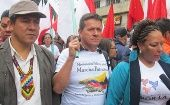 Huber Ballesteros, center, at agrarian march, Colombia.