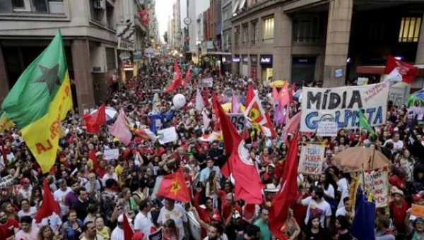 People attend a protest against impeachment proceedings against Brazil
