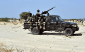 Niger soldiers ride in a military vehicle on May 25, 2015 in Malam Fatori, in northern Nigeria, near the border with Niger.