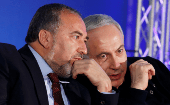 srael's Prime Minister Benjamin Netanyahu (R) converses with former Foreign Minister Avigdor Lieberman during a Likud-Yisrael Beitenu campaign rally in the southern Israeli city of Ashdod Jan. 16, 2013