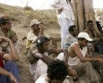 A group of Brazilian slave laborers listens to a Labor Ministry inspector (R) explain their legal rights on the Bom Jesus farm in the Amazon basin.
