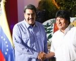 Bolivian President Evo Morales is welcomed by his Venezuelan counterpart Nicolas Maduro at the Maiquetia International Airport of Caracas, Venezuela, May 21, 2016.