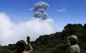 People take pictures of an eruption of the Turrialba volcano, from San Gerardo de Irazu near Turrialba, March 13, 2015.