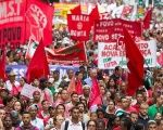 Members of trade unions and social movements march in defense of the government of Dilma Rousseff, in the city of Sao Paulo.