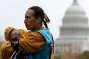 A Navajo man stands outside the U.S. Capitol in Washington, DC