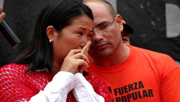 Keiko Fujimori and Joaquin Ramirez.