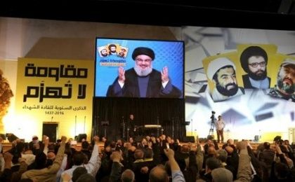 Hezbollah leader Sayyed Hassan Nasrallah addresses supporters through a giant screen during a rally in Beirut
