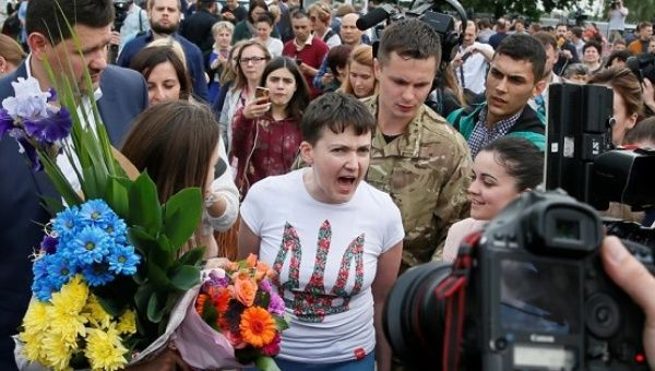 Ukrainian servicewoman Nadiya Savchenko talks to the media at Boryspil International airport outside Kiev, Ukraine, May 25, 2016.