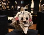 A Puebloan Kachina Huhuwa mask and other Native American artifacts at a 2014 Paris auction.