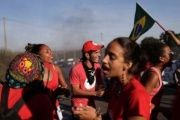 In Brasilia, members of the Landless MST workers movement join in protest.