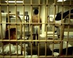 An inmate stands in his cell at the Orange County jail in Santa Ana, California.