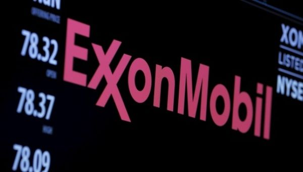 The logo of Exxon Mobil Corporation is shown on a monitor above the floor of the New York Stock Exchange in New York.
