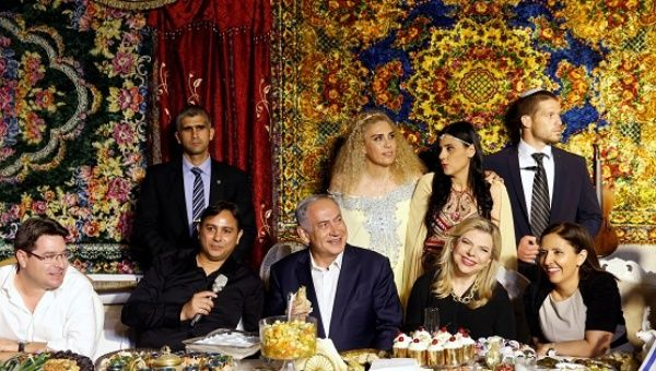 Israeli Prime Minister Benjamin Netanyahu and his wife Sara (2nd R, seated) attend the Mimona, a ceremony traditionally celebrated by Jews from North Africa at the end of the Passover holidays, at the town of Yavne, south of Tel Aviv, Israel, Apr. 30, 2016.