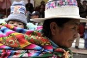 An Aymara woman carries her baby.