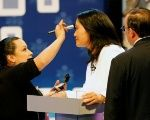 Peru's presidential candidate Keiko Fujimori is tended to during a presidential debate in Lima, Peru.