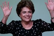 Suspended President Dilma Rousseff waves during the launch ceremony of the book