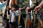 Yemeni children hold automatic rifles as they join grown up relatives in a tribal gathering.