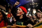 Women shout slogans during a protest against Brazil's interim President Michel Temer and in support of President Dilma Rousseff in Sao Paulo.