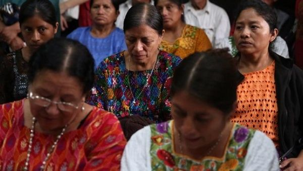Widows of victims of the civil war attend a hearing announcing that eight former officers will be sent to trial, Guatemala City, June 7, 2016.