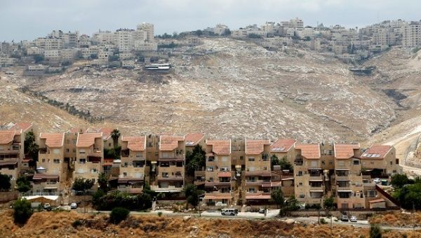 Houses are seen in the West Bank Jewish settlement of Maale Adumim as the Palestinian village of Al-Eizariya is seen in the background.