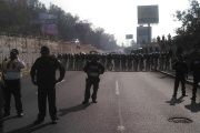 Riot police once again block entry to Mexico City by one of the CNTE caravans.