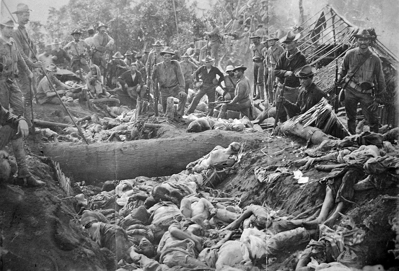 The bodies of Moro insurgents and civilians killed by U.S. troops during the Battle of Bud Dajo in the Philippines, March 7, 1906.