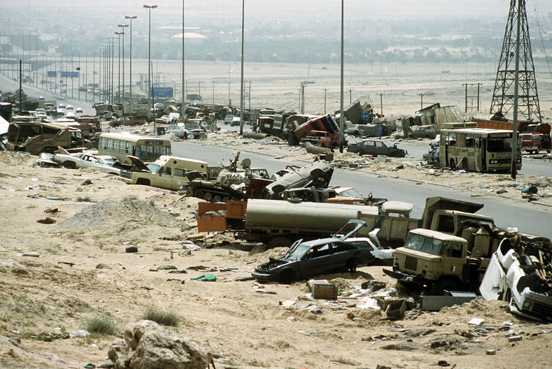 "Destroyed Iraqi civilian and military vehicles on the ""Highway of Death,"" officially known as Highway 80, during the First Gulf War April 1991."