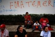A sit-in protest against Brazil's interim president where the phrase on the wall reads