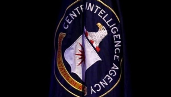 The CIA flag is displayed on stage during a conference on national security.