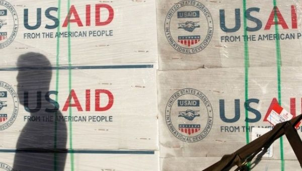 A shadow is cast on boxes of relief items from U.S. Agency for International Development.