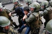 A demonstrator is detained by riot police during a protest against government education reforms in Valparaiso city, Chile, June 9, 2016.