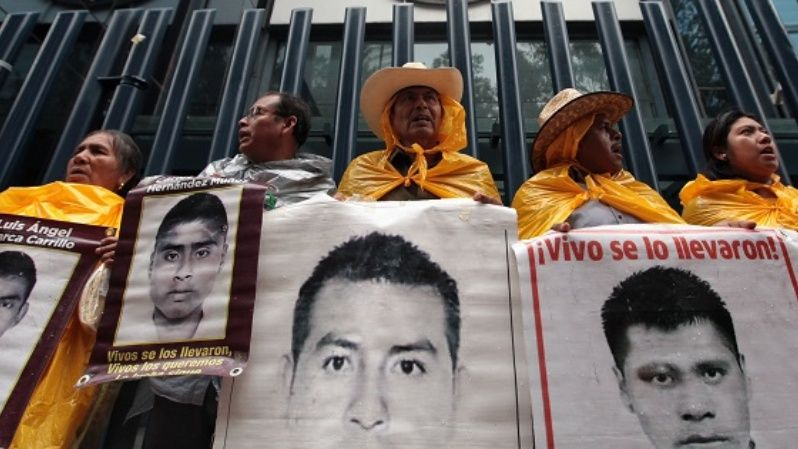 Families of the 43 forcibly disappeared Ayotzinapa students protest outside the Attorney General
