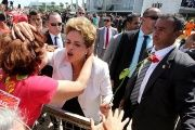 Suspended Brazilian President Dilma Rousseff greets a supporter after the Brazilian Senate voted to suspend her, at Planalto Palace in Brasilia, May 12, 2016.