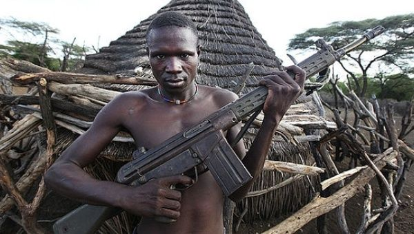 A South Sudanese man holding a HK G3.