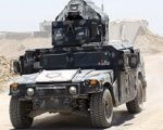 An Iraqi security military vehicle is seen on the outskirts of Fallujah, Iraq.