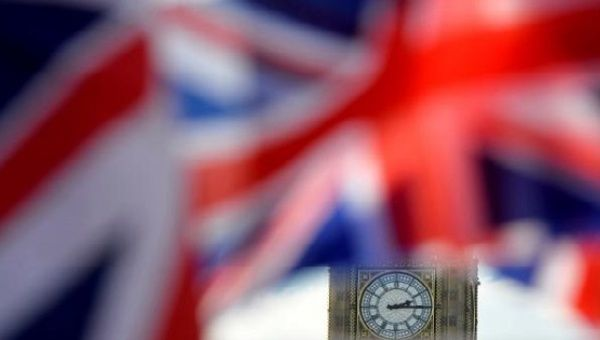 British Union flags fly in front of the Big Ben clocktower of the Houses of Parliament in central London, Britain February 24, 2016.